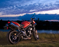 Sport Bike at Dusk. Sport Bike parked at Dusk on kickstand Royalty Free Stock Photography