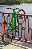 Sport bike parked on a bridge over the river. Transport Stock Image