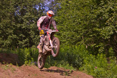 A sport bike rider jumps springboard stock photography