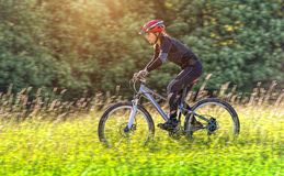 Sport bike woman in a beautiful meadow Stock Photo