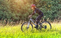 Sport bike woman in a beautiful meadow stock photo