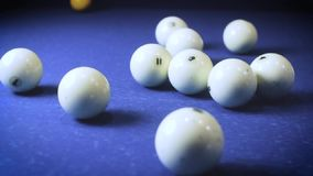 Sport billiard balls set arranged in shape of triangle on blue billiard table in pub. Players make the first round. Stroke. The beginning of the billiard game stock video footage
