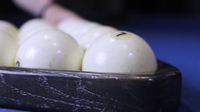 Sport billiard balls set arranged in shape of triangle on green billiard table in pub. Players are ready for the first. Hit of the round to start the billiard stock video