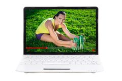 Sport blog concept - sporty woman showing her outdoor training o. Nline in video on laptop screen Stock Image