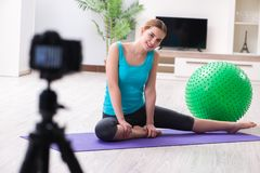 The sport blogger recording video for vlog. Sport blogger recording video for vlog Royalty Free Stock Images