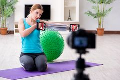 The sport blogger recording video for vlog. Sport blogger recording video for vlog Royalty Free Stock Image
