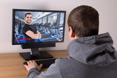 Sport and blogging concept - man watching sport video blog onlin Stock Image