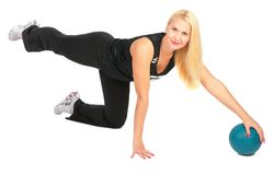 Sport blond makes exercise with ball Royalty Free Stock Photography