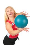 Sport blond makes exercise with ball Stock Photography