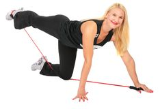 Sport blond makes exercise with rope Royalty Free Stock Images