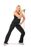 Sport blond makes exercise with rope Royalty Free Stock Image