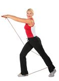 Sport blond makes exercise with rope Stock Photography