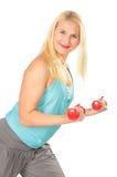 Sport blond mit Dumbbells Lizenzfreies Stockfoto