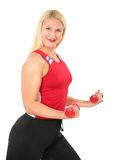 Sport blond woman makes exercise with dumbbells Royalty Free Stock Photography