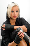 Sport blond woman wear black hoodie fitness. Outfit kick-boxer Stock Image