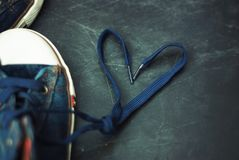 Sport blue Jeans Boots Children Heart Shape Laces over Textured Grounge Chalckboard. Toned. Education and Parenting. Sport blue Jeans Boots Children Heart Shape royalty free stock images