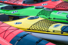 Sport boats, kayaks and canoes at the marina Royalty Free Stock Images