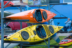 Sport boats, kayaks and canoes at the marina Stock Photos