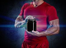 Sport, bodybuilding, strength and people concept - young man sta Stock Photo