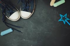 Sport Boots Children education Grounge Textured Blackboard with chalk Copy space. royalty free stock photo