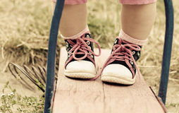 Sport boots on infant legs Stock Image