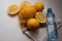 Sport bottle and lemons Stock Photos