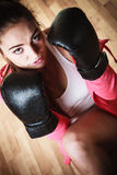 Sport boxer woman in black gloves boxing Stock Photo