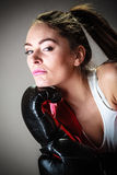 Sport boxer woman in black gloves boxing Stock Photography