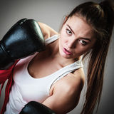 Sport boxer woman in black gloves boxing Royalty Free Stock Photography