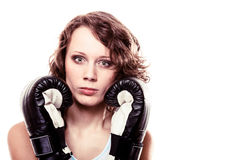 Sport boxer woman in black gloves. Fitness girl training kick boxing. Stock Images