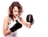 Sport boxer woman in black gloves. Fitness girl training kick boxing Royalty Free Stock Image