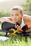 Sport boy with a bicycle outside Royalty Free Stock Photo