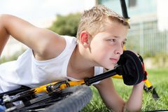 Sport boy and bike outside Stock Photo