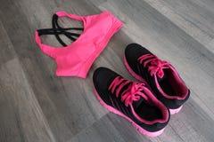 Sport bra and shoes. Sport bra and sport shoes royalty free stock photos