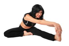 Sport brunette in black  makes exercise Royalty Free Stock Photo