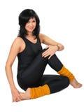 Sport brunette in black  makes gymnastic Royalty Free Stock Images