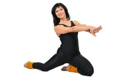 Sport brunette in black  makes gymnastic Royalty Free Stock Photos
