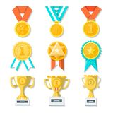 Sport or business trophy award icons set. Hanging medals, gold cups and gold awards on white. stock image