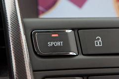 Sport button in sportscar Royalty Free Stock Image