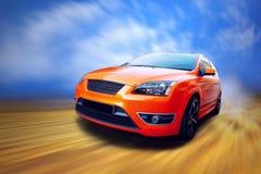 Sport car. Beautiful orange sport car on road Stock Photography