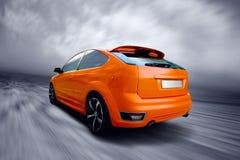 Sport car. Beautiful orange sport car on road Royalty Free Stock Photos