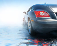 Sport car. Reflected in water Royalty Free Stock Images