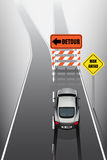 Sport car is braking when see detour signs Royalty Free Stock Photo