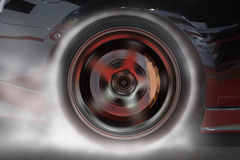 Sport car burning rear tire to heat up rubber for good traction before start to race.  stock photos