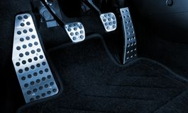 Sport car chrome pedals. (toned in blue Stock Images