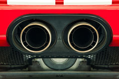 Sport car exhaust pipe. Sport car exhaust twin pipe close up Stock Photos
