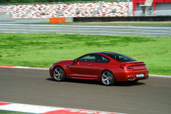 Sport car fast moving on track Stock Images