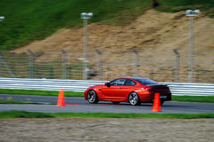 Sport car fast moving on track royalty free stock photography