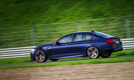 Sport car fast moving on track Royalty Free Stock Images
