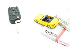 Sport car with keys and money Royalty Free Stock Photos